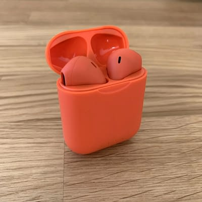 red colored wireless pods